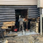 Tearing Down Damaged Log Wall